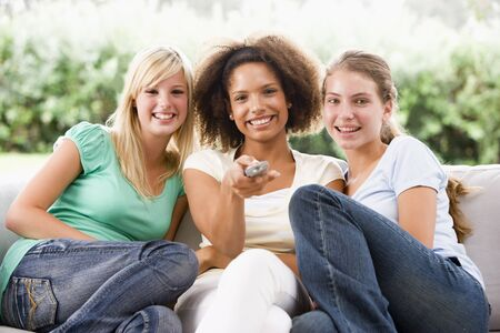 Teenage Girls Sitting On Couch  photo