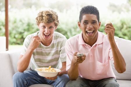 Teenage Boys Sitting On Couch Together  photo