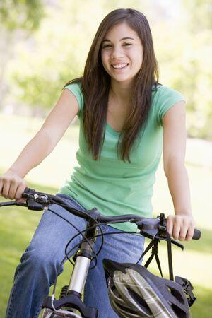 Teenage Girl On Bicycle photo