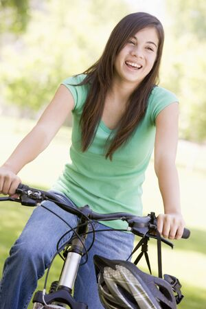 Teenage Girl On Bicycle photo
