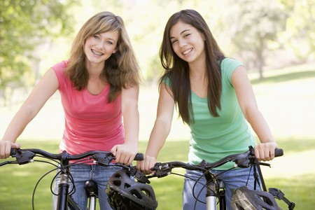 jeans girl: Teenage Girls On Bicycles Stock Photo