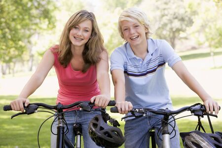 Teenage Boy And Girl On Bicycles photo