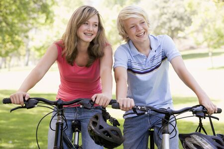 Teenage Boy And Girl On Bicycles Stock Photo - 4445971