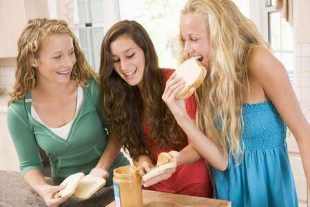 Teenage Girls Making Sandwiches photo