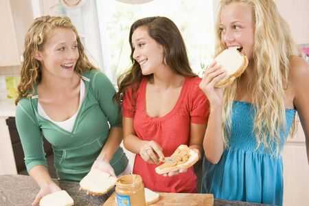 Teenage Girls Making Sandwiches photo