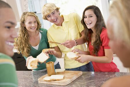 16 year old girls: Teenagers Making Sandwiches Stock Photo