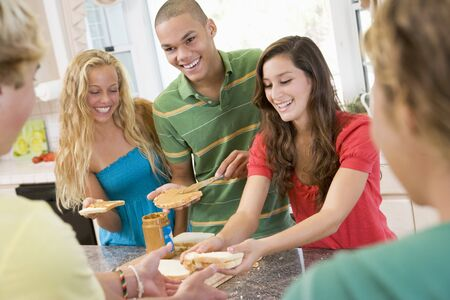 blond 16 year old: Teenagers Making Sandwiches Stock Photo