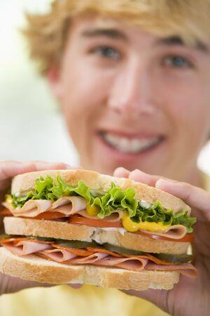 Teenage Boy Eating Sandwich Reklamní fotografie - 4446016