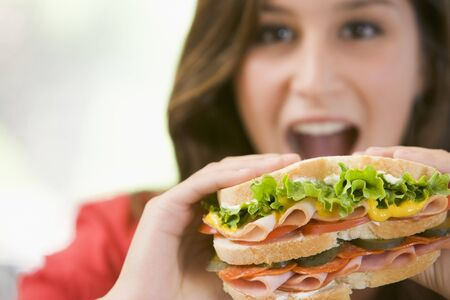Teenage Girl Eating Sandwich Stock Photo - 4445564