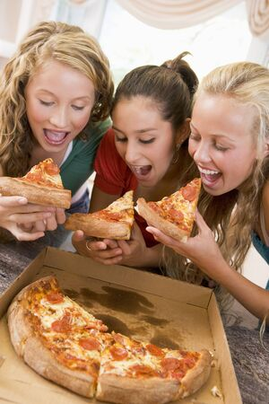 girl friends: Teenage Girls Eating Pizza  Stock Photo
