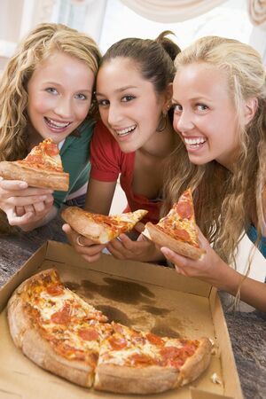 Teenage Girls Eating Pizza  photo