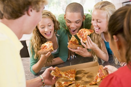 group of teens: Group Of Teenagers Eating Pizza