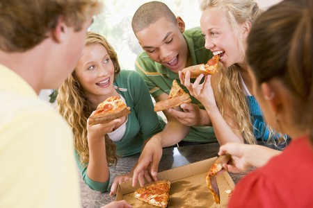 Group Of Teenagers Eating Pizza Stock Photo - 4446417
