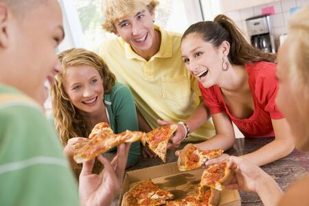 Group Of Teenagers Eating Pizza  photo