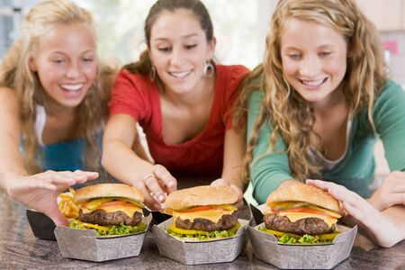 Teenage Girls Eating Burgers  photo
