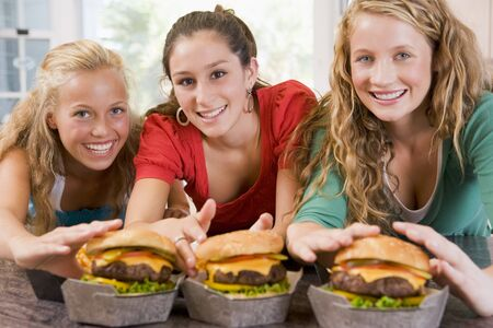 Teenage Girls Eating Burgers Stock Photo - 4446486