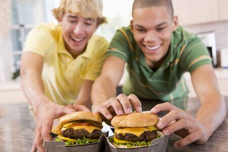 Teenage Boys Eating Burgers Stock Photo - 4445496