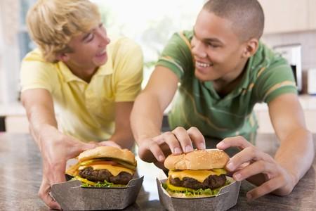 Teenage Boys Eating Burgers Stock Photo - 4445664