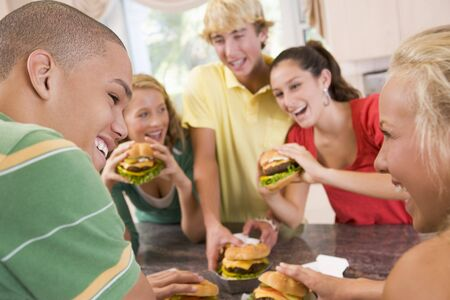 Teenagers Eating Burgers Stock Photo - 4445798