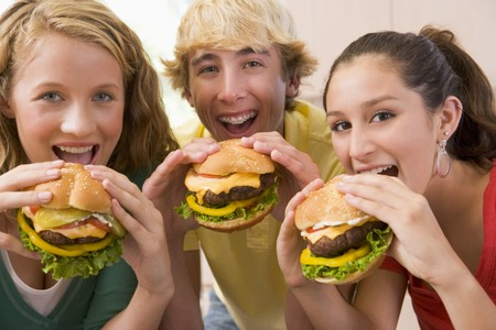 16 year old girls: Teenagers Eating Burgers