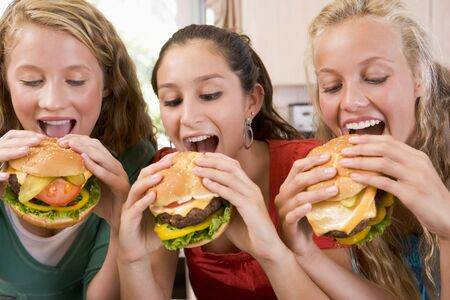 latin food: Teenage Girls Eating Burgers