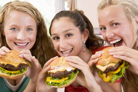 Teenage Girls Eating Burgers  Stock Photo - 4446485