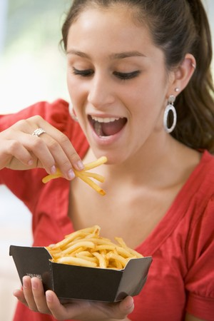 Teenage Girl Eating French Fries  photo
