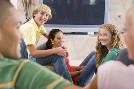 Teenagers Hanging Out In Front Of Television  photo