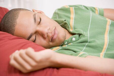 Teenage Boy Lying On Bed photo