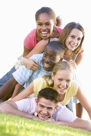 15 18: Group Of Teenagers Having Fun Outdoors  Stock Photo