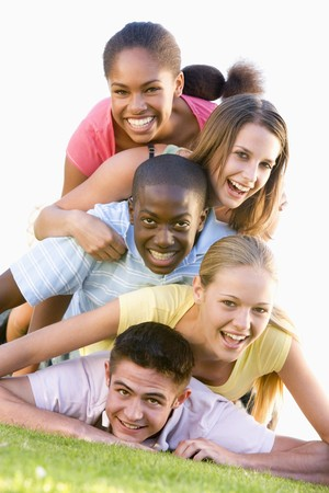 happy teens: Group Of Teenagers Having Fun Outdoors  Stock Photo