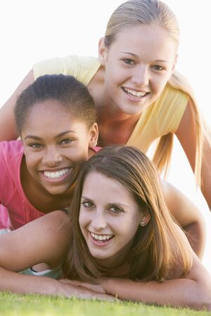 youth group: Teenage Girls Having Fun Outdoors  Stock Photo