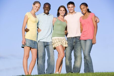 15 18: Portrait Of A Group Of Teenagers Outdoors