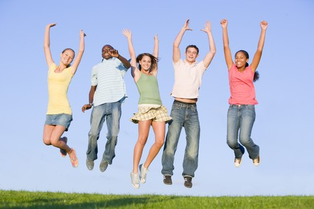 Portrait Of A Group Of Teenagers Jumping  photo