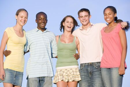 Portrait Of A Group Of Teenagers Outdoors  photo
