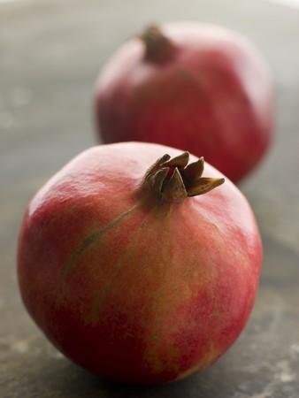 pommegranates: Two whole pommegranates