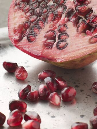 pommegranate: Halved pommegranate with seeds