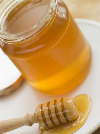 Jar of honey and spoon photo