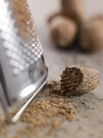 grater: Nutmeg and grater Stock Photo