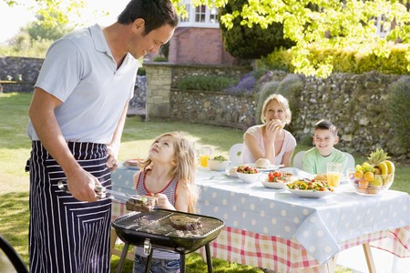 Family Enjoying A Barbeque Stock Photo - 4507145