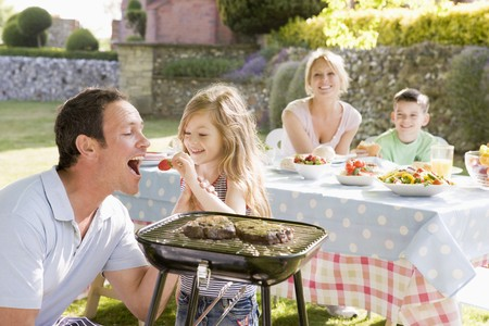 Family Enjoying A Barbeque Stock Photo - 4507109