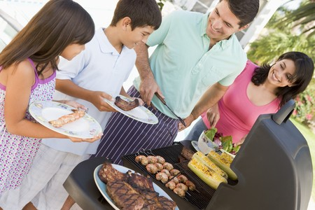 cookout: Family Enjoying A Barbeque Stock Photo