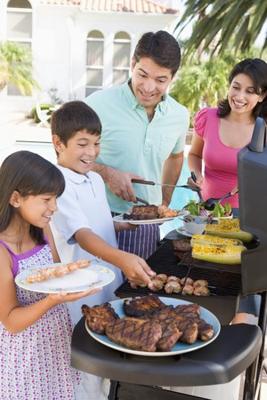 Family Enjoying A Barbeque Stock Photo - 4507038