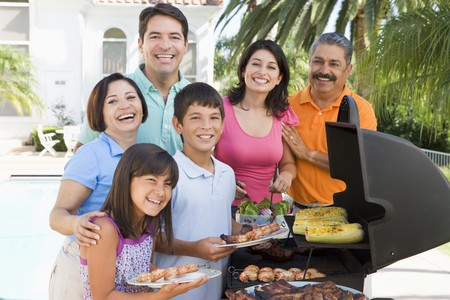 multi family house: Family Enjoying A Barbeque Stock Photo
