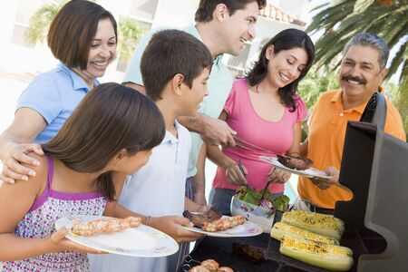 Family Enjoying A Barbeque photo