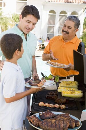 Family Enjoying A Barbeque Stock Photo - 4507143