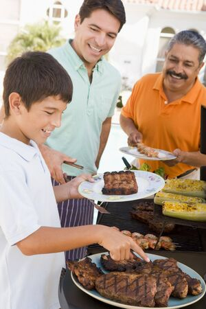 preadolescent: Family Enjoying A Barbeque Stock Photo