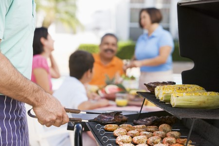 Family Enjoying A Barbeque Stock Photo - 4506940