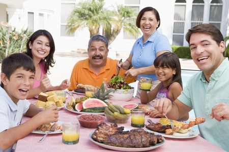 Family Enjoying A Barbeque Stock Photo - 4507111