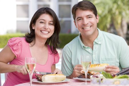 Couple Enjoying A Barbequed Meal In The Garden Stock Photo - 4506948